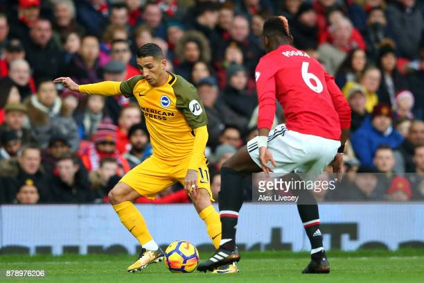 Anthony Knockaert of Brighton and Hove Albion and Paul Pogba of Manchester United battle for the ball during the Premier League match between...