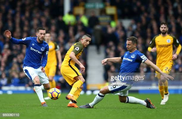 Anthony Knockaert of Brighton and Hove Albion and Phil Jagielka of Everton battle for the ball during the Premier League match between Everton and...