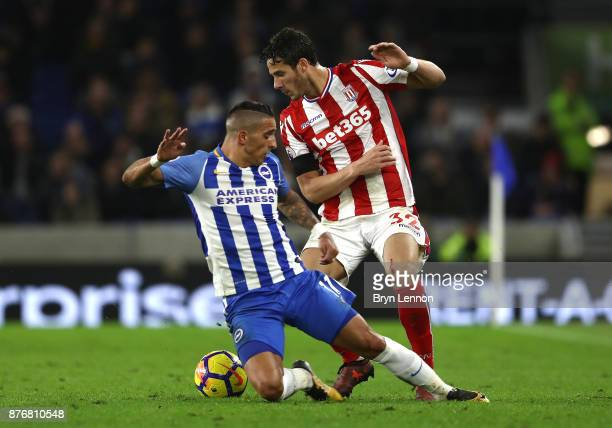 Anthony Knockaert of Brighton and Hove Albion and Ramadan Sobhi of Stoke City battle for the ball during the Premier League match between Brighton...