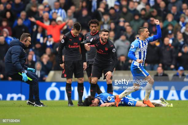 Anthony Knockaert of Brighton and Hove Albion appeals after Sead Kolasinac of Arsenal collides with Ezequiel Schelotto during the Premier League...