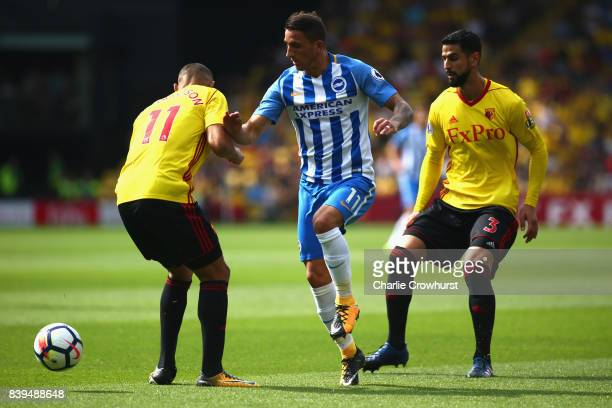 Anthony Knockaert of Brighton and Hove Albion attempts to get past Richarlison de Andrade of Watford and Miguel Britos of Watford during the Premier...