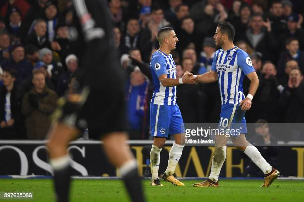 Anthony Knockaert of Brighton and Hove Albion celebrates with teammate Tomer Hemed after scoring his sides first goal during the Premier League match...