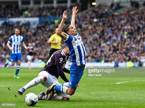 Anthony Knockaert of Brighton and Hove Albion goes down in the penalty area under the challenge from George Thorne of Derby County during the Sky Bet...