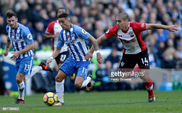 Anthony Knockaert of Brighton and Hove Albion holds off Oriol Romeu of Southampton during the Premier League match between Brighton and Hove Albion...