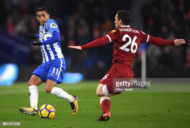 Anthony Knockaert of Brighton and Hove Albion is challenged by Andy Robertson of Liverpool during the Premier League match between Brighton and Hove...
