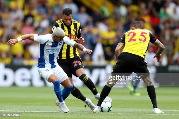 Anthony Knockaert of Brighton and Hove Albion is challenged by Etienne Capoue of Watford and Jose Holebas of Watford during the Premier League match...
