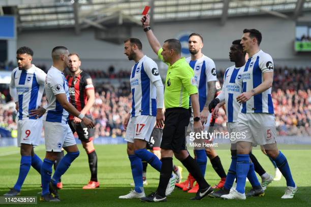 Anthony Knockaert of Brighton and Hove Albion is shown a red card by referee Kevin Friend during the Premier League match between Brighton Hove...