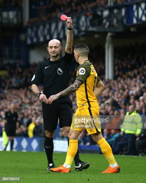 Anthony Knockaert of Brighton and Hove Albion is shown a red card by referee Roger East during the Premier League match between Everton and Brighton...
