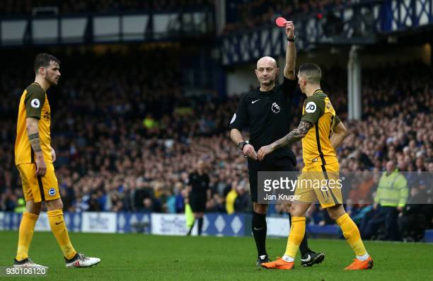 Anthony Knockaert of Brighton and Hove Albion is shown a red card by referee during the Premier League match between Everton and Brighton and Hove...