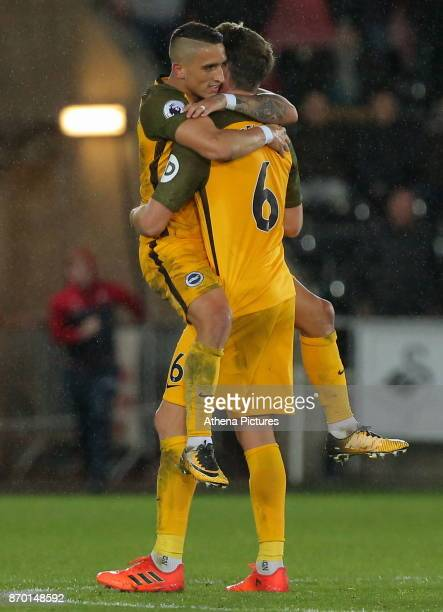 Anthony Knockaert of Brighton and team mate Dale Stephens celebrateb their win during the Premier League match between Swansea City and Brighton and...