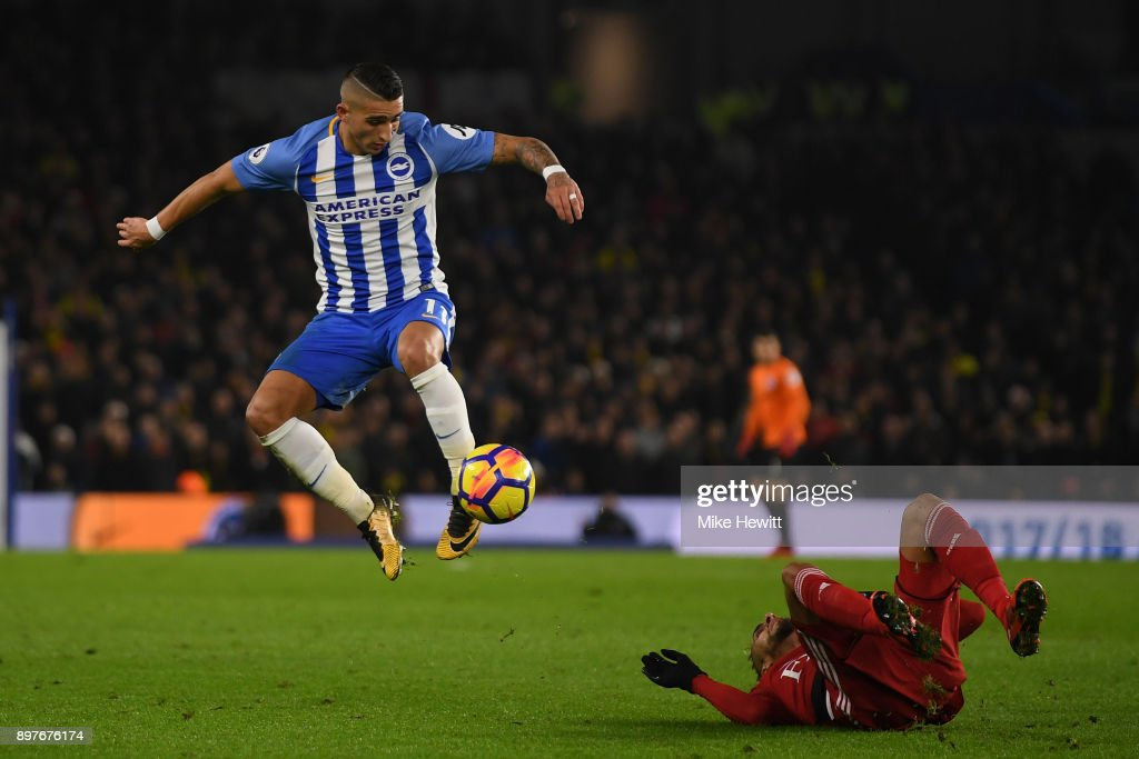 Anthony Knockaert of Brighton gets away from Roberto Pereyra of Watford during the Premier League match between Brighton and Hove Albion and Watford at Amex Stadium on December 23, 2017 in Brighton, England.