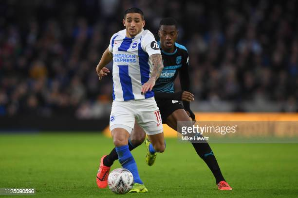 Anthony Knockaert of Brighton & Hove Albion is challenged by Tosin Adarabioyo of West Bromwich Albion during the FA Cup Fourth Round match between...