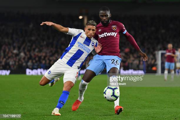 Anthony Knockaert of Brighton Hove Albion tangles with Arthur Masuaku of West Ham United during the Premier League match between Brighton Hove Albion...