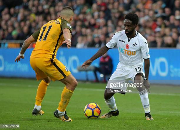Anthony Knockaert of Brighton stands against Nathan Dyer of Swansea City during the Premier League match between Swansea City and Brighton and Hove...