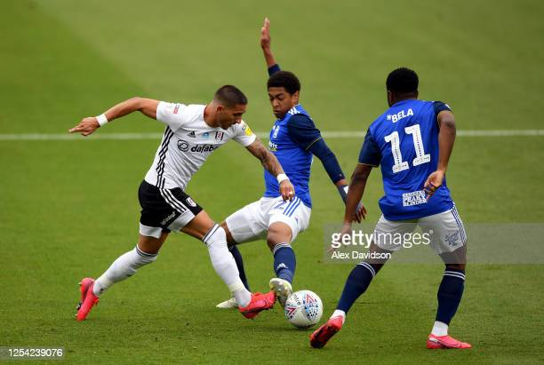 Anthony Knockaert of FUlham battles for possession with Jude Bellingham and Jeremie Bela of Birmingham City during the Sky Bet Championship match...