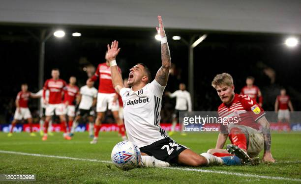 Anthony Knockaert of Fulham is fouled by Hayden Coulson of Middlesbrough FC during the Sky Bet Championship match between Fulham and Middlesbrough at...