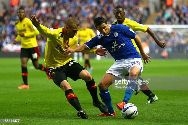 Anthony Knockaert of Leicester City holds off the challenge by Joel Ekstrand of Watford during the npower Championship Play Off Semi Final First Leg...