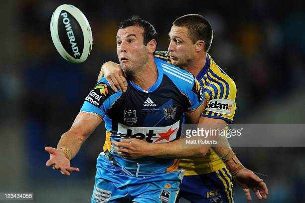 Anthony Laffranchi of the Titans attempts to regain control of the ball in the tackle during the round 26 NRL match between the Gold Coast Titans and...
