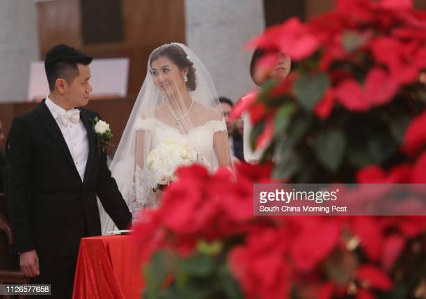 Anthony Lam Yue-yeung and his wife Erica Yuen Mi-ming attend their wedding ceremony at Cathedral of The Immaculate Conception at Caine Road in...