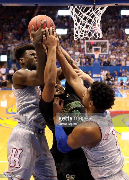 Anthony Lamb of the Vermont Catamounts battles Udoka Azubuike and Dedric Lawson of the Kansas Jayhawks for a rebound during the game at Allen...