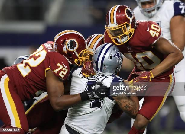 Anthony Lanier II of the Washington Redskins and Josh HarveyClemons of the Washington Redskins combine to sack Dak Prescott of the Dallas Cowboys in...