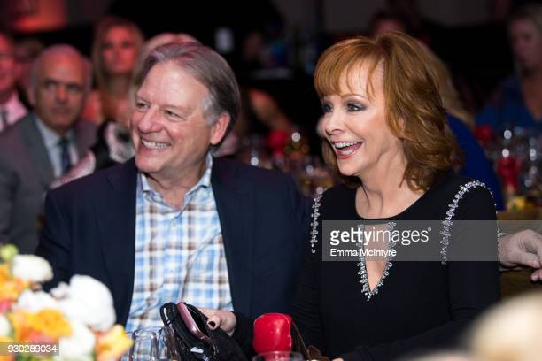Anthony Lasuzzo and Reba McEntire attend the Celebrity Fight Night's Founders Club Dinner on March 9 2018 in Phoenix Arizona