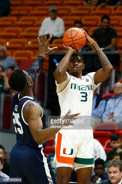 Anthony Lawrence II of the Miami Hurricanes attempts a three pointer against the Yale Bulldogs during the HoopHall Miami Invitational at American...
