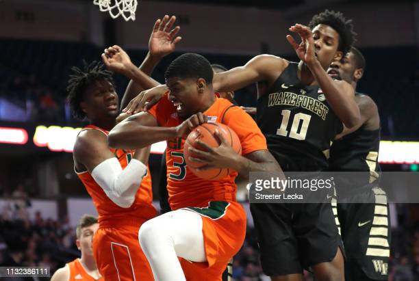 Anthony Lawrence II of the Miami Hurricanes battles for the ball against Jaylen Hoard of the Wake Forest Demon Deacons during their game at LJVM...