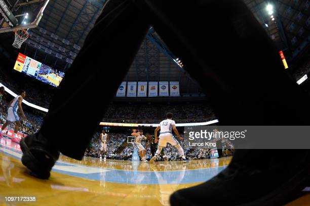Anthony Lawrence II of the Miami Hurricanes drives against Luke Maye of the North Carolina Tar Heels at Dean Smith Center on February 9 2019 in...