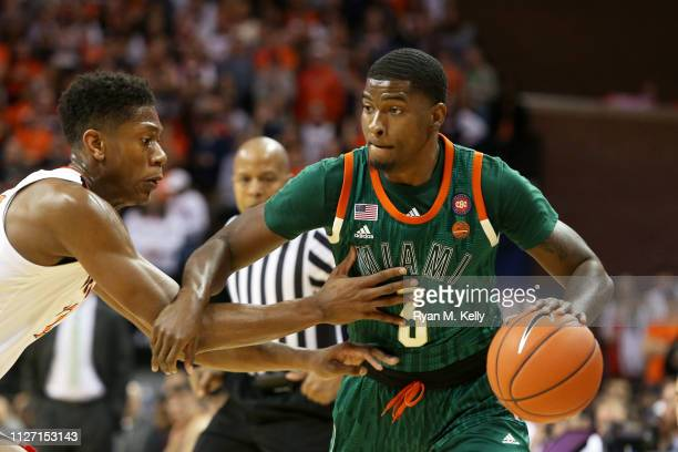 Anthony Lawrence II of the Miami Hurricanes drives past De'Andre Hunter of the Virginia Cavaliers in the first half during a game at John Paul Jones...
