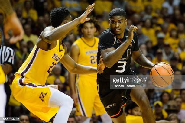 Anthony Lawrence II of the Miami Hurricanes drives to the basket against Davonte Fitzgerald of the Minnesota Golden Gophers during the game on...