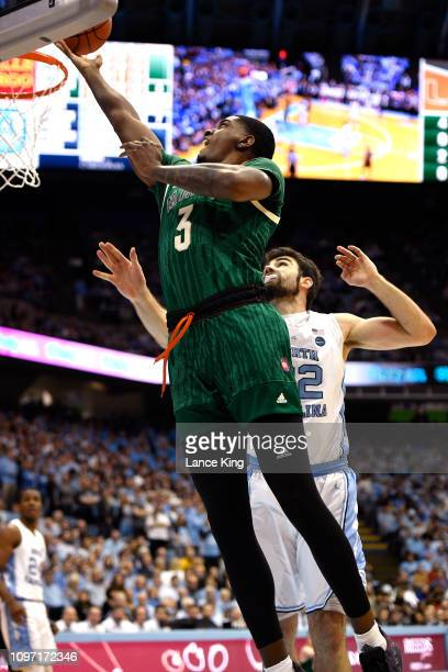 Anthony Lawrence II of the Miami Hurricanes goes to the basket against the North Carolina Tar Heels at Dean Smith Center on February 9 2019 in Chapel...
