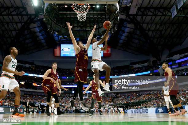 Anthony Lawrence II of the Miami Hurricanes goes up for a shot agains Cameron Krutwig of the Loyola Ramblers in the first half in the first round of...