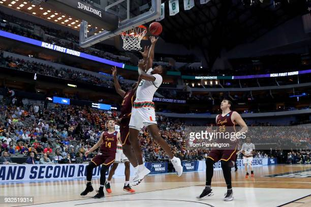 Anthony Lawrence II of the Miami Hurricanes goes up for a shot against Donte Ingram of the Loyola Ramblers in the first round of the 2018 NCAA Men's...