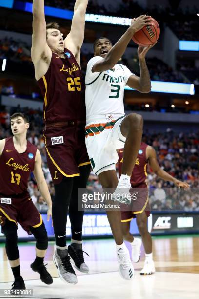 Anthony Lawrence II of the Miami Hurricanes goes up for a shot against Cameron Krutwig of the Loyola Ramblers in the first half in the first round of...