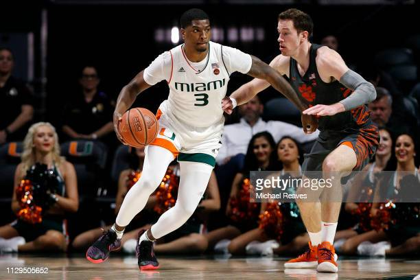 Anthony Lawrence II of the Miami Hurricanes is guarded by David Skara of the Clemson Tigers during the first half at the Watsco Center on February 13...