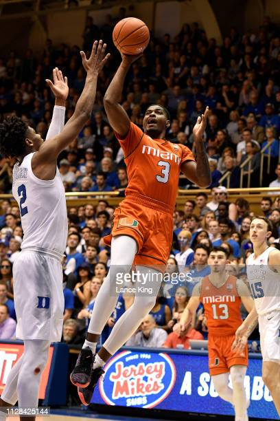 Anthony Lawrence II of the Miami Hurricanes puts up a shot against Cam Reddish of the Duke Blue Devils in the second half at Cameron Indoor Stadium...