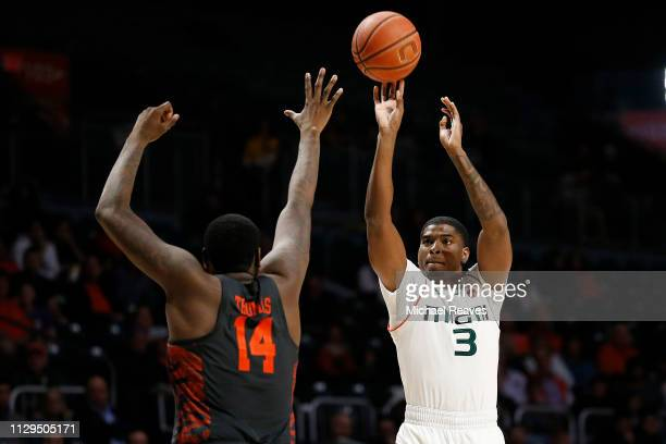 Anthony Lawrence II of the Miami Hurricanes shoots a three pointer against the Clemson Tigers during the second half at the Watsco Center on February...