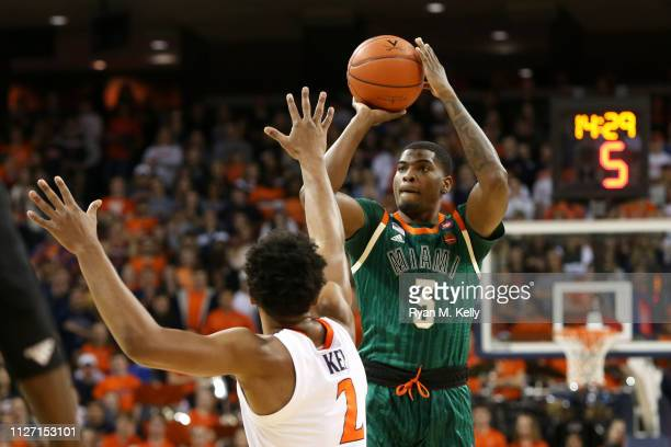 Anthony Lawrence II of the Miami Hurricanes shoots over Braxton Key of the Virginia Cavaliers in the first half during a game at John Paul Jones...