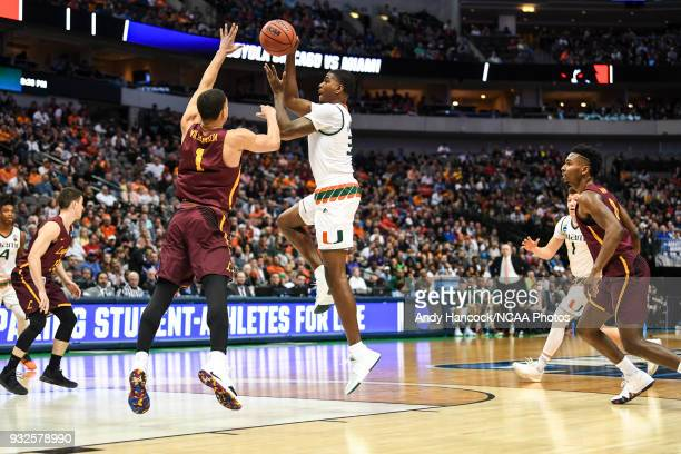 Anthony Lawrence II of the Miami Hurricanes shoots over Lucas Williamson of the Loyola Ramblers during the first round of the 2018 NCAA Men's...