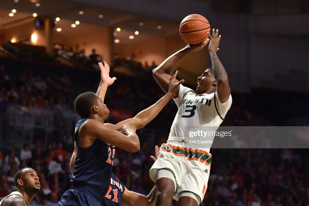 Anthony Lawrence II #3 of the Miami Hurricanes shoots the basketball while being defended by Mamadi Diakite #25 and Isaiah Wilkins #21 of the Virginia Cavaliers during the second half of the game at The Watsco Center on February 13, 2018 in Miami, Florida.