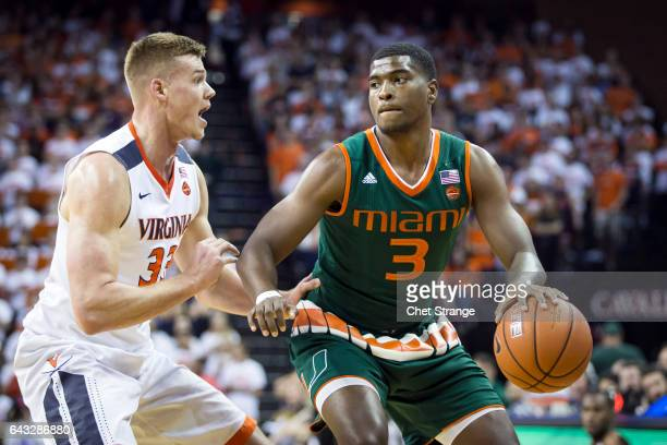 Anthony Lawrence Jr #3 of the Miami Hurricanes is guarded by Jack Salt of the Virginia Cavaliers during a game at John Paul Jones Arena on February...