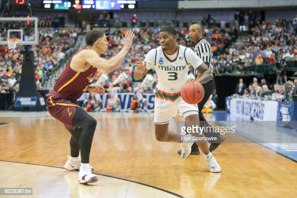 Anthony Lawrence Jr of the Miami Hurricanes dribbles the ball during the NCAA Div I Men's Championship First Round basketball game between Loyola of...