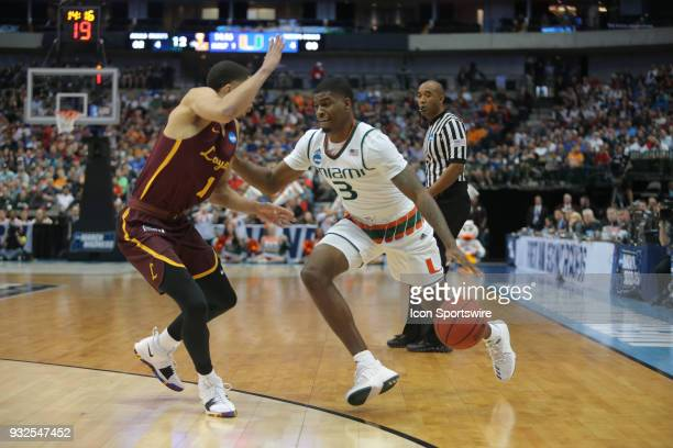 Anthony Lawrence Jr of the Miami Hurricanes drives around G Lucas Williamson of the LoyolaChicago Ramblers during the NCAA Division I Men's...