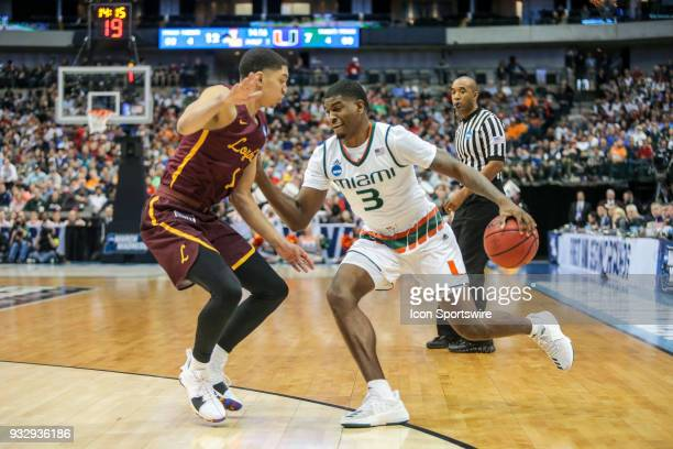 Anthony Lawrence Jr of the Miami Hurricanes drives to the basket during the NCAA Div I Men's Championship First Round basketball game between Loyola...
