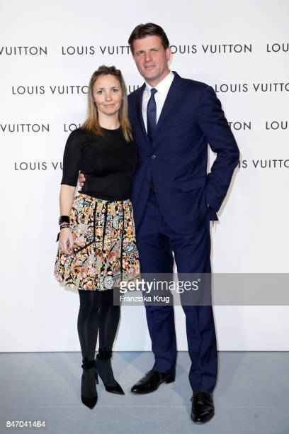 Anthony Ledru and his partner Victoria Alianelli wearing Louis Vuitton attend the 'Louis Vuitton Time Capsule' Exhibition Opening at Franzoesisches...