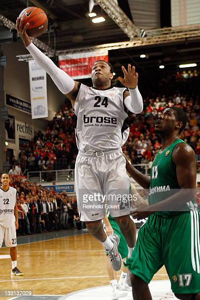 Anthony Leon Tucker, #24 of Brose Baskets Bamberg drives to the basket against Steven Smith, #17 of Panathinaikos Athens during the 2011-2012 Turkish...