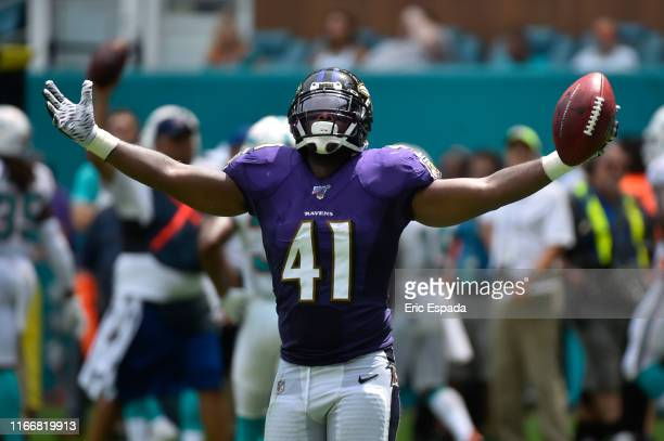 Anthony Levine of the Baltimore Ravens celebrates after a fake punt in the second quarter of the game at Hard Rock Stadium on September 8 2019 in...