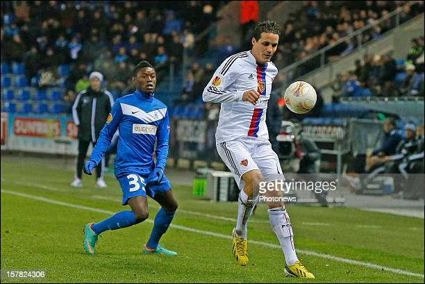Anthony Limbombe of KRC Genk battles for the ball with Philipp Degen of FC Basel 1893 during the UEFA Europa League group G match between KRC Genk...