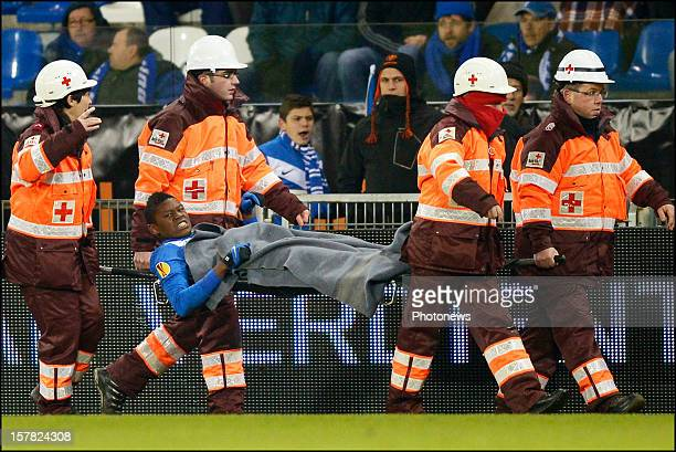 Anthony Limbombe of KRC Genk is carried off the pitch on a stretcher after suffering an injury during the UEFA Europa League group G match between...